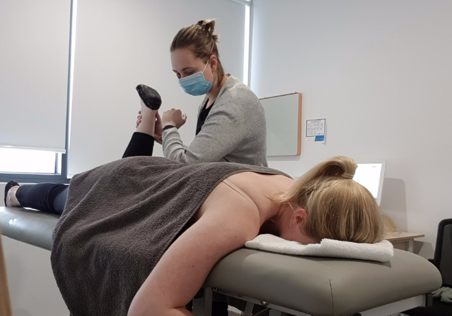 Osteopath Emily Colgan treating a client